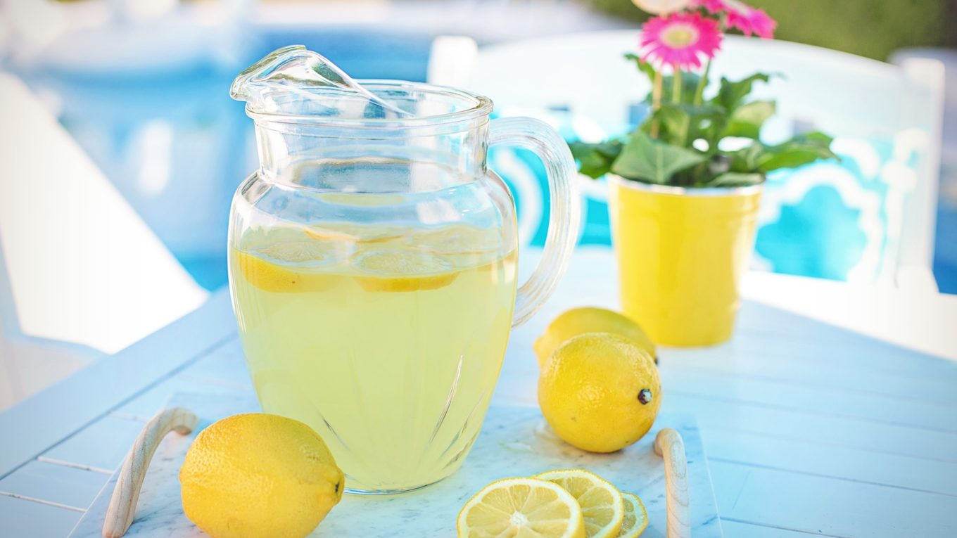 Limoncello and lemons in a jug